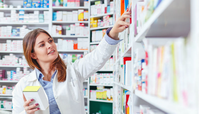 Photo 20of 20a 20professional 20pharmacist 20checking 20stock 20in 20an 20aisle 20of 20a 20local 20drugstore 202 1